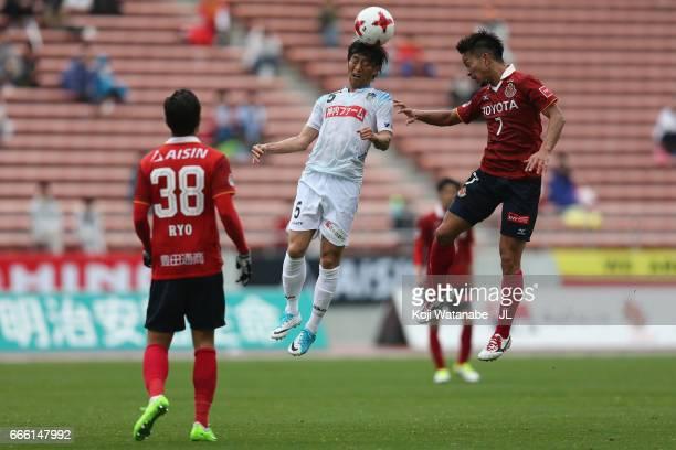 Daigo Watanabe of Kamatamare Sanuki and Taishi Taguchi of Nagoya Grampus compete for the ball during the J.League J2 match between Nagoya Grampus and...