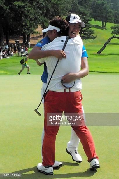 Daijiro Izumida is congratulated by Shota Akiyoshi after winning the RIZAP KBC Augusta at Keya Golf Club on August 26 2018 in Itoshima Fukuoka Japan