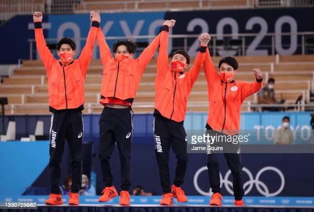 Daiki Hashimoto, Kazuma Kaya, Takeru Kitazono, and Wataru Tanigawa of Team Japan react during the medal ceremony after winning the silver medal in...