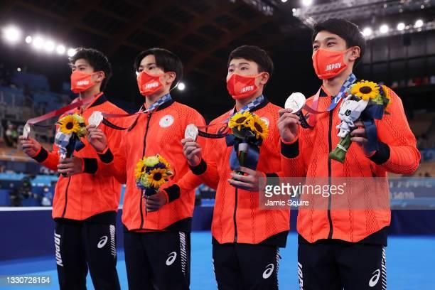 Daiki Hashimoto, Kazuma Kaya, Takeru Kitazono, and Wataru Tanigawa of Team Japan pose with the silver medal during the medal ceremony after the Men's...