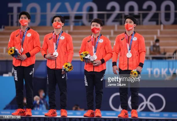 Daiki Hashimoto, Kazuma Kaya, Takeru Kitazono, and Wataru Tanigawa of Team Japan look on during the medal ceremony after winning the silver medal in...