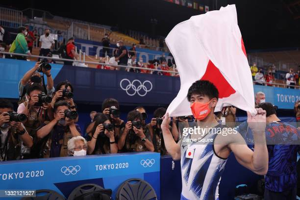 Daiki Hashimoto of Team Japan celebrates winning gold during the Men's Horizontal Bar Final on day eleven of the Tokyo 2020 Olympic Games at Ariake...