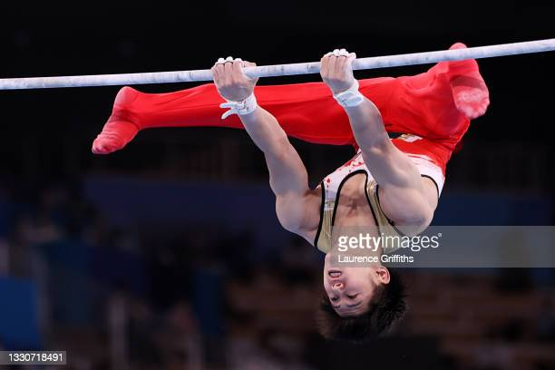 Daiki Hashimoto of Team Japan competes on horizontal bar during the Men's Team Final on day three of the Tokyo 2020 Olympic Games at Ariake...