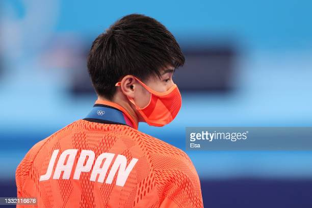 Daiki Hashimoto of Team Japan looks on from the podium during the Men's Horizontal Bar Final medal ceremony on day eleven of the Tokyo 2020 Olympic...