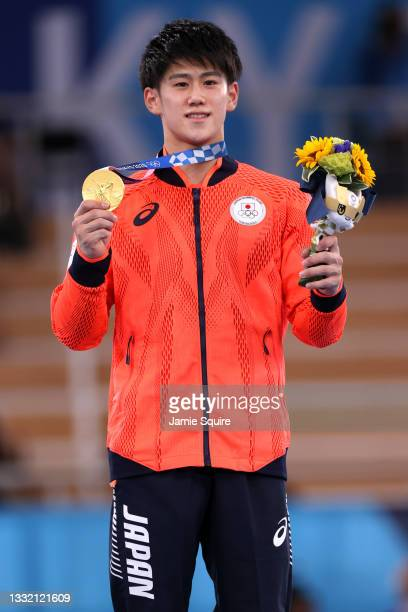 Daiki Hashimoto of Team Japan poses with the gold medal during the Men's Horizontal Bar Final medal ceremony on day eleven of the Tokyo 2020 Olympic...