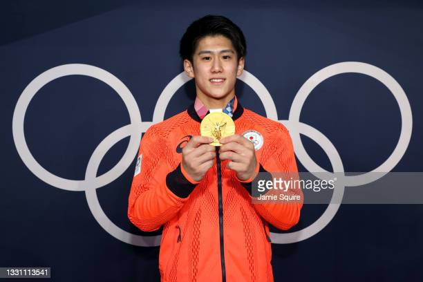 Daiki Hashimoto of Team Japan poses with the gold medal for the Men's All-Around Final on day five of the Tokyo 2020 Olympic Games at Ariake...