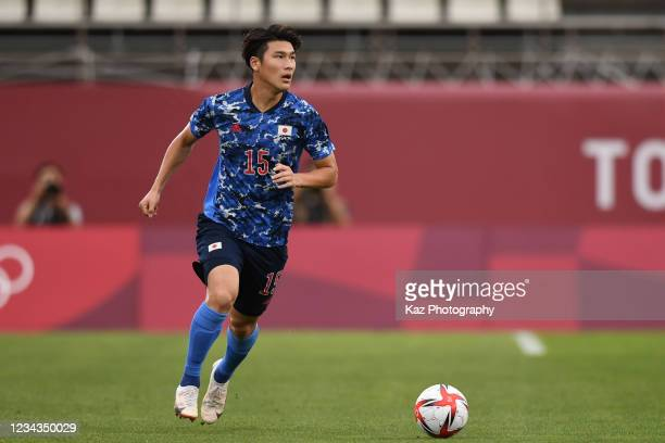 Daiki Hashioka of Japan dribbles the ball during the Men's Quarter Final match on day eight of the Tokyo 2020 Olympic Games at Kashima Stadium on...