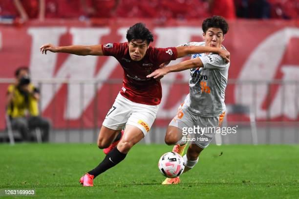 Daiki Hashioka of Urawa Red Diamonds and Kenta Nishizawa of Shimizu S-Pulse compete for the ball during the J.League Meiji Yasuda J1 match between...