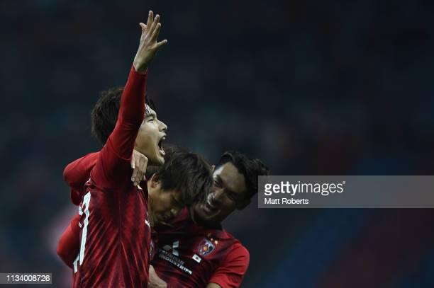 Daiki Hashioka of Urawa Red Diamonds celebrates scoring a goal with Koya Yuruki and Tomoaki Makino during the AFC Champions League Group G match...