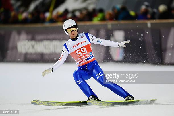 Daiki Ito of Japan competes in the qualification round on day 1 of the Four Hills Tournament Ski Jumping event at SchattenbergSchanze on December 28...