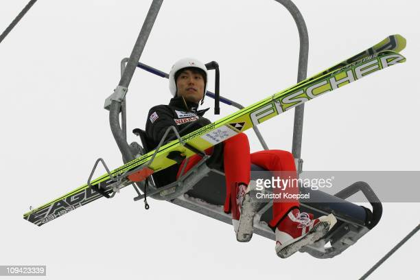 Daiki Ito of Japan rides the chairlift prior to competing in the Men's Ski Jumping HS106 Qualification round during the FIS Nordic World Ski...