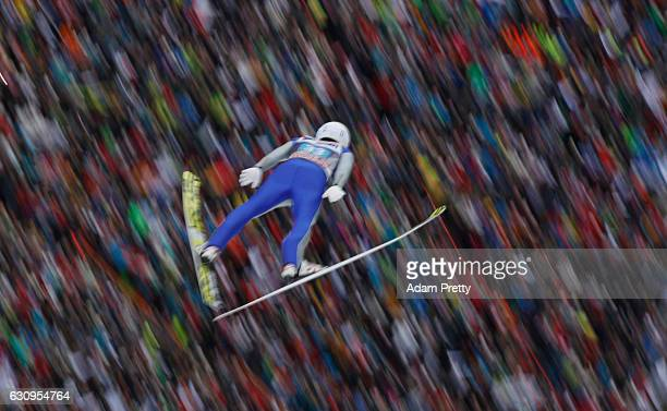 Daiki Ito of Japan soars through the air during his first competition jump on Day 2 on January 4 2017 in Innsbruck Austria
