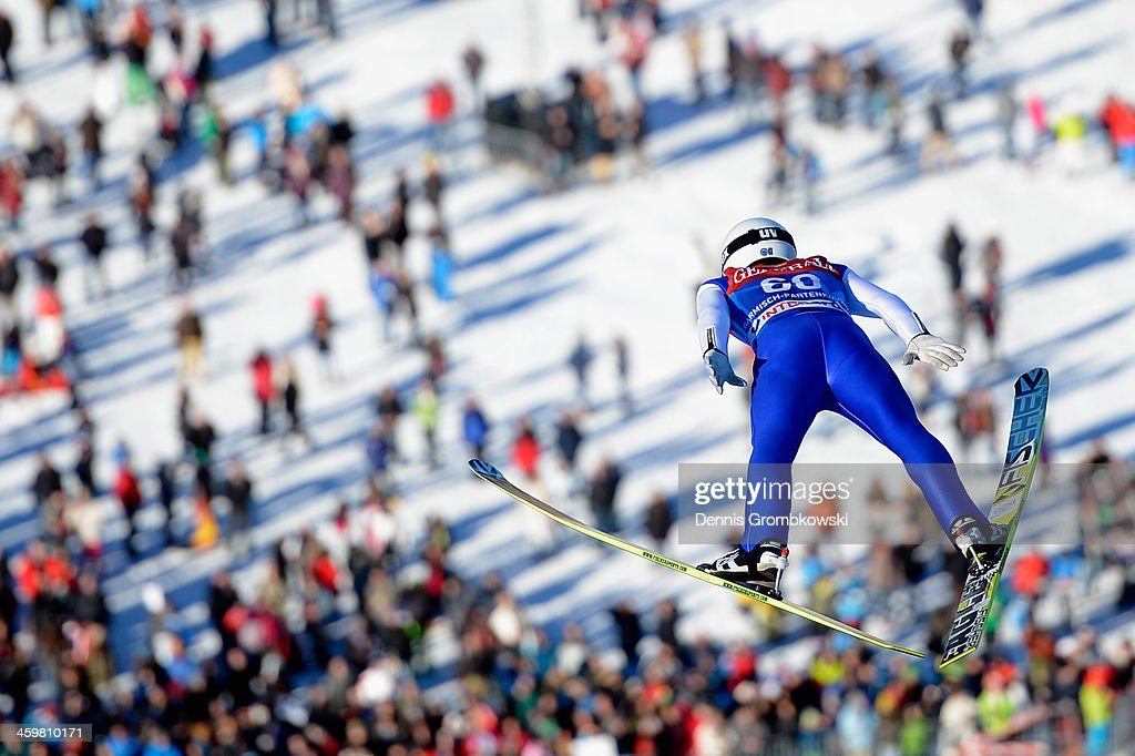 Daiki Ito of Japan soars through the air during his second training jump on day 1 of the Four Hills Tournament event on December 31, 2013 in Garmisch-Partenkirchen, Germany.