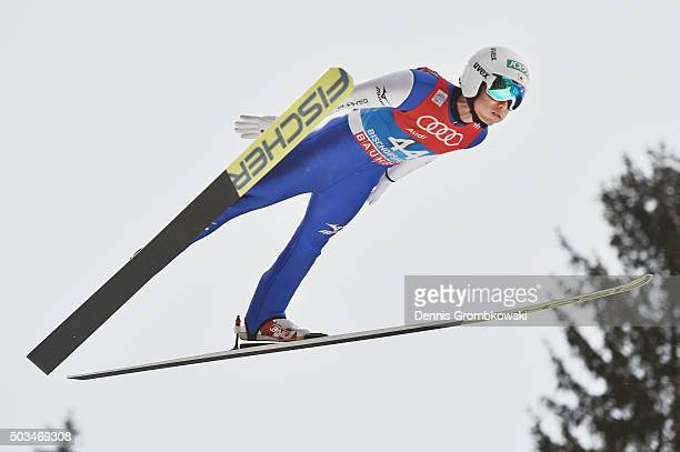 Daiki Ito of Japan soars through the air during his trial jump on Day 1 of the Bischofshofen 64th Four Hills Tournament ski jumping event on January...