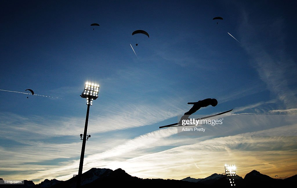 Daiki Ito of Japan soars through the air with paragliders during his practice jump on Day 2 of the 64th Four Hills Tournament on December 29, 2015 in Oberstdorf, Germany.