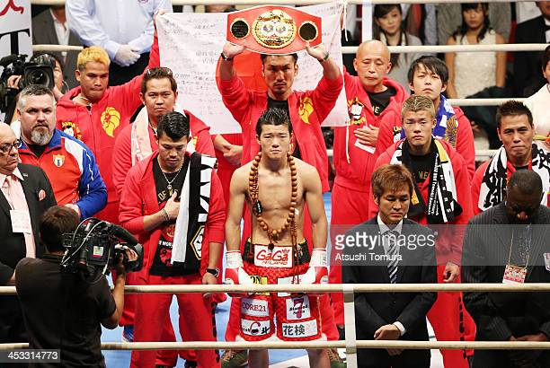 Daiki Kameda of Japan stands up for the national anthem prior to the IBF Super Flyweight /WBA World Super Flyweight double titles match against...