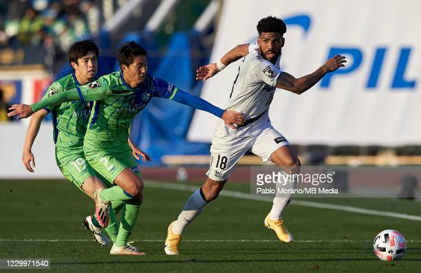 Daiki Kaneko of Shonan Bellmare competes for the ball with Anderson Patric Aguiar Oliveira of Gamba Osaka during the J.League Meiji Yasuda J1 match...