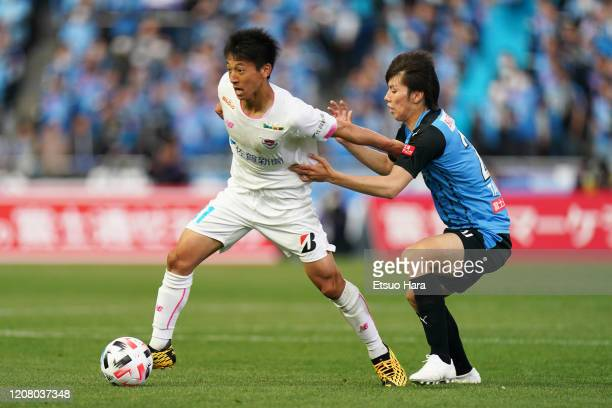 Daiki Matsuoka of Sagan Tosu and Ao Tanaka of Kawasaki Frontale compete for the ball during the JLeague MEIJI YASUDA J1 match between Kawasaki...