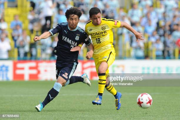Daiki Ogawa of Jubilo Iwata and Dudu of Kashiwa Reysol compete for the ball during the JLeague Levain Cup Group A match between Kashiwa Reysol and...