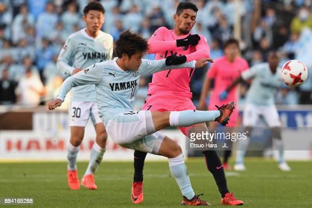 Daiki Ogawa of Jubilo Iwata controls the ball under pressure of Pedro Junior of Kashima Antlers during the JLeague J1 match between Jubilo Iwata and...