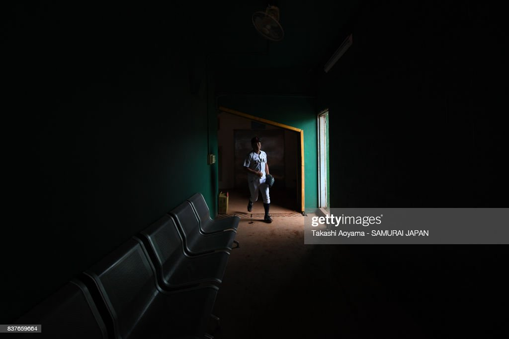 Daiki Sakamoto #11 of Japan walks in the field from the bullpen during the Baseball Group B match between Japan and United States during the Universiade Taipei at Xinzhuang Baseball Stadium on August 23, 2017 in Taipei, Taiwan.