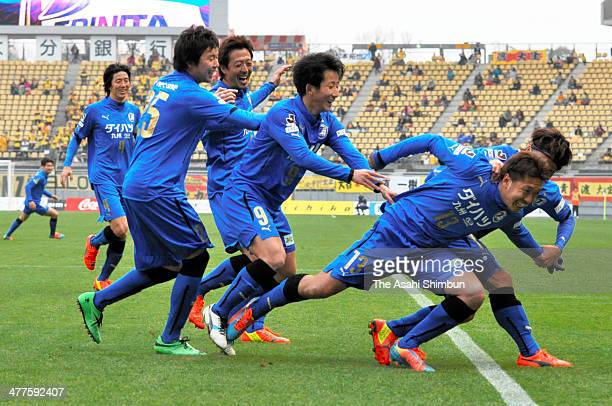 Daiki Takamatsu of Oita Trinita celebrates scoring his team's first goal from the spot with his teammates during the JLeague second division match...