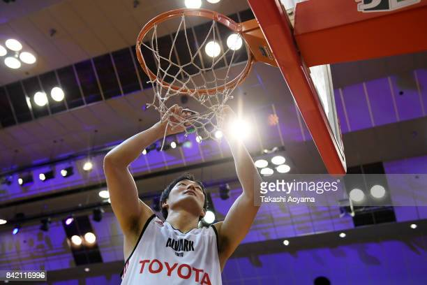 Daiki Tanaka of the Alvark Tokyo cuts down the net after defeating the Chiba Jets 77-73 in the B.League Kanto Early Cup final between Alvark Tokyo...