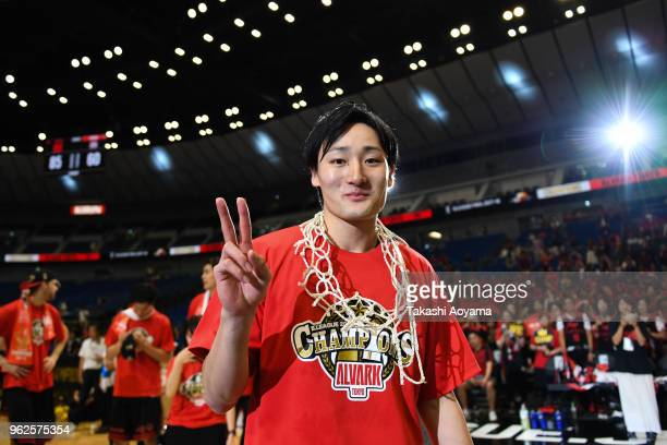 Daiki Tanaka of the Alvark Tokyo cuts down the net after defeating the Chiba Jets 85-60 the B.League Championship Final between Alvark Tokyo and...