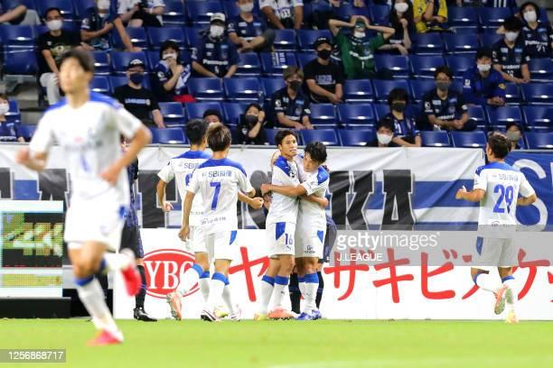 Daiki Watari of Oita Trinita celebrates scoring his side's first goal with his team mates during the J.League Meiji Yasuda J1 match between Gamba...