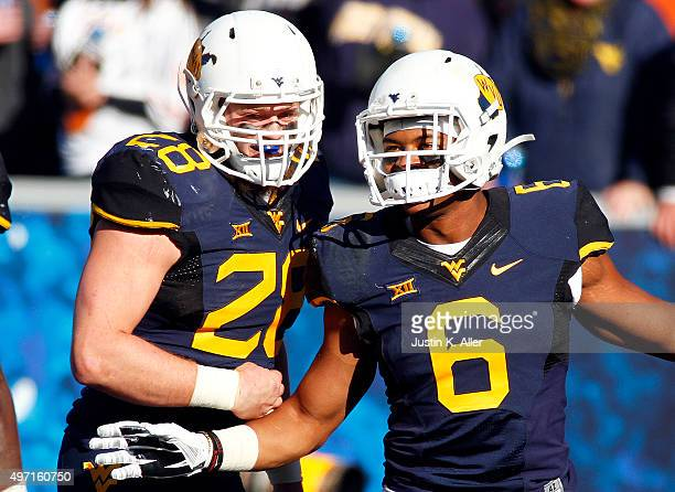 Daikiel Shorts of the West Virginia Mountaineers celebrates with Elijah Wellman after catching a 8 yard touchdown pass in the second half during the...