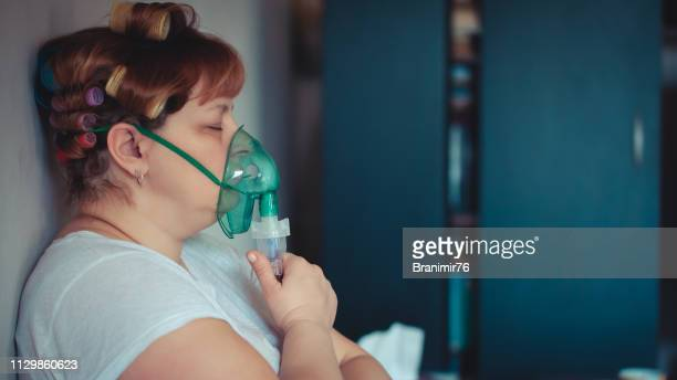 daily asthma care - mother and son - respiratory machine stock pictures, royalty-free photos & images