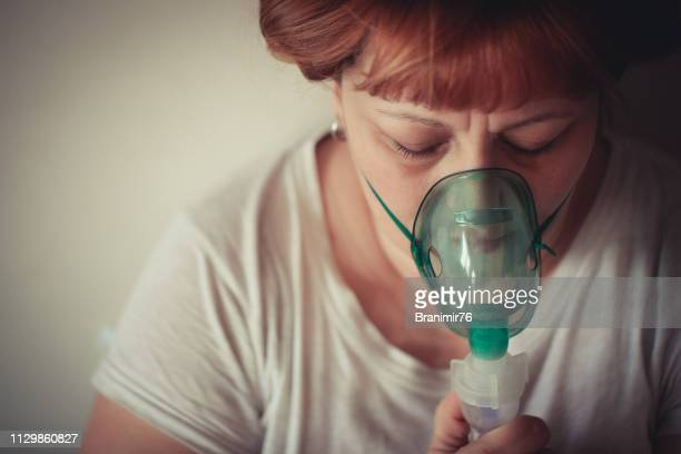 daily asthma care - mother and son - patient on ventilator stock pictures, royalty-free photos & images