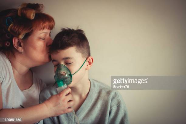 daily asthma care - mother and son - respiratory machine stock photos and pictures