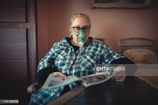 daily asthma care - senior woman - patient on ventilator stock pictures, royalty-free photos & images