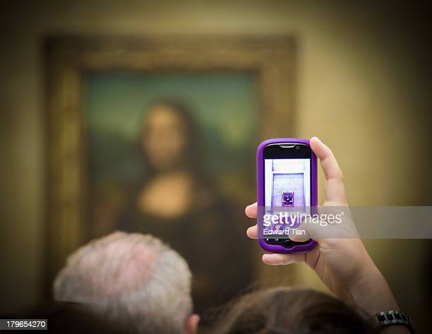 CONTENT] A daily challenge for tourist visiting the Louvre to catch a glimpse of Leonardo da Vinci's halflength portrait of Mona Lisa As shown here a...