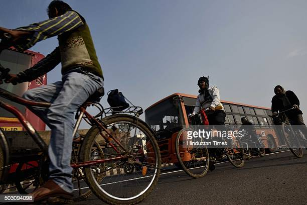 Daily commuter using cycles on the first day of Delhi's OddEven Vehicle Plan on January 1 2016 in New Delhi India The oddeven scheme that allows odd...
