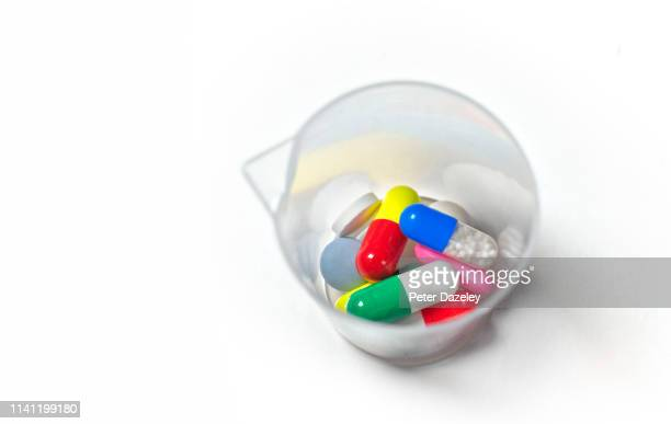daily dose of medication - ibuprofen stock pictures, royalty-free photos & images