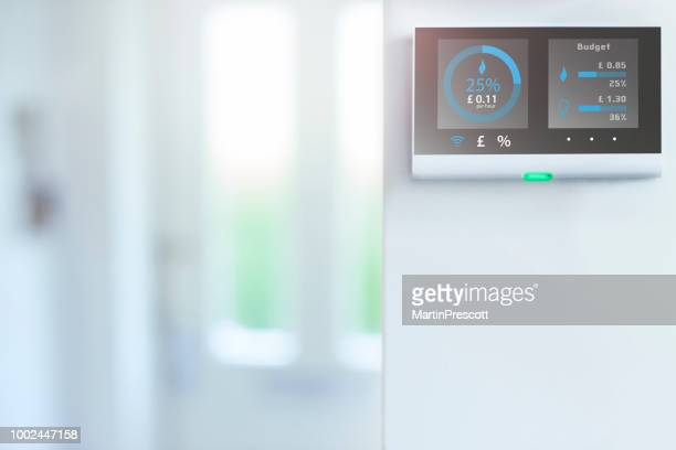 daily energy costs in the home - thermostat stock photos and pictures