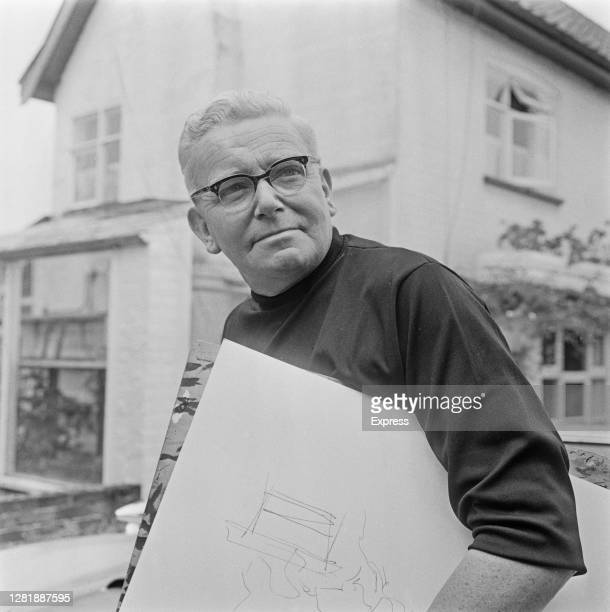 Daily Express cartoonist Carl Giles , known professionally as Giles, at his home, UK, 9th August 1966.