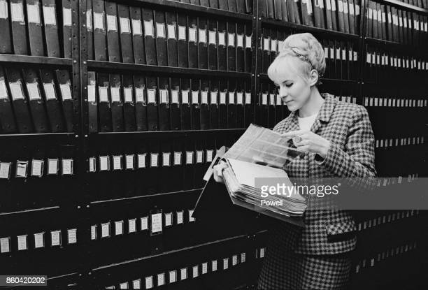 A 'Daily Express' employee browsing the newspaper's picture library collection UK 3rd March 1967