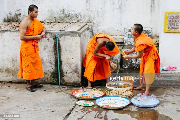 daily life at a buddhist monastery. - dafos stock photos and pictures