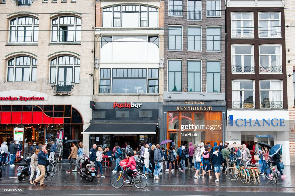 "Daily life in Amsterdam, Netherlands, on August 18th, 2017. Amsterdam is one of the most beautiful, creative and cycle-friendly cities in Europe. Its got a great mix of a cosmopolitan vibe and a relatively small size, meaning theres a village-like charm to it. Thousands of people visit Amsterdam during the month of August. The most visited places are usually, the Dam square, the Rijksmuseum, the ""I am Amsterdam"" letters situated in front of this museum, etc."