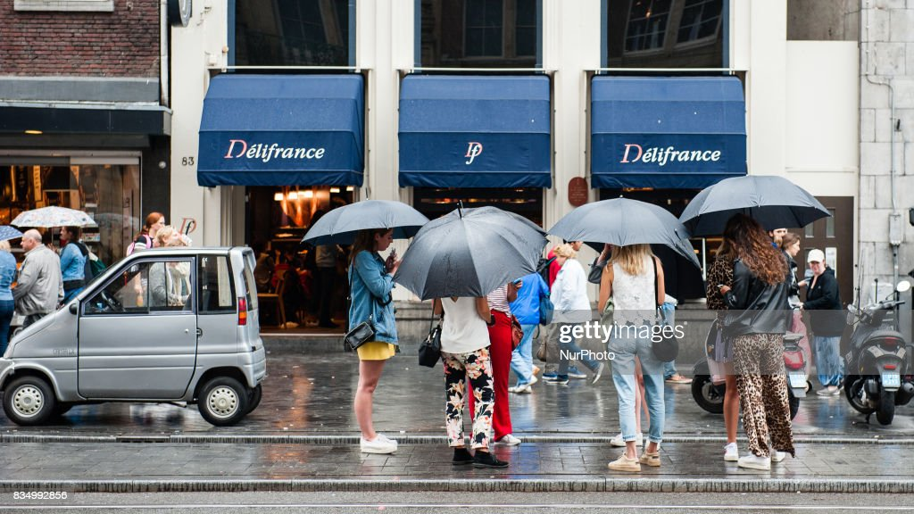 """Daily life in Amsterdam, Netherlands, on August 18th, 2017. Amsterdam is one of the most beautiful, creative and cycle-friendly cities in Europe. Its got a great mix of a cosmopolitan vibe and a relatively small size, meaning theres a village-like charm to it. Thousands of people visit Amsterdam during the month of August. The most visited places are usually, the Dam square, the Rijksmuseum, the """"I am Amsterdam"""" letters situated in front of this museum, etc."""