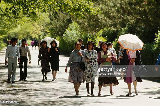 Daily life in Kabul one year before the civil war and at the beginning of the Soviet troop withdrawal Yound men and women stroll in Kabul park