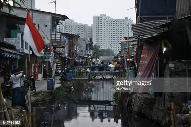 Daily life in one of Jakarta's slums area in North Jakarta on September 10 2017 Indonesian Central Bureau of Statistics reported the level of...