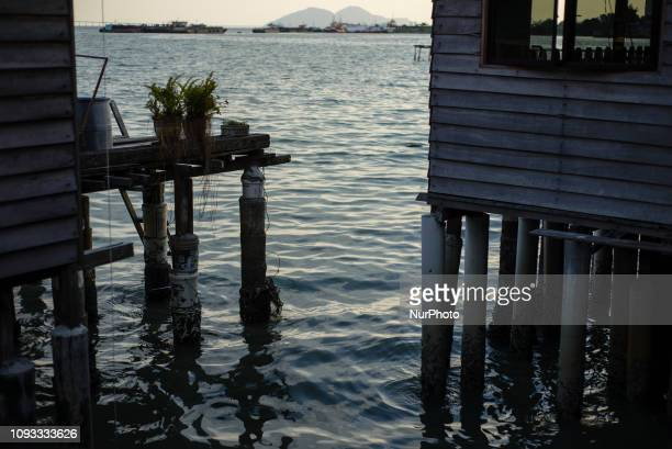 Daily life in the Clan Jetties villages George Town Penang Island Malaysia in January 2019 The Clan Jetties of George Town are the traditional water...