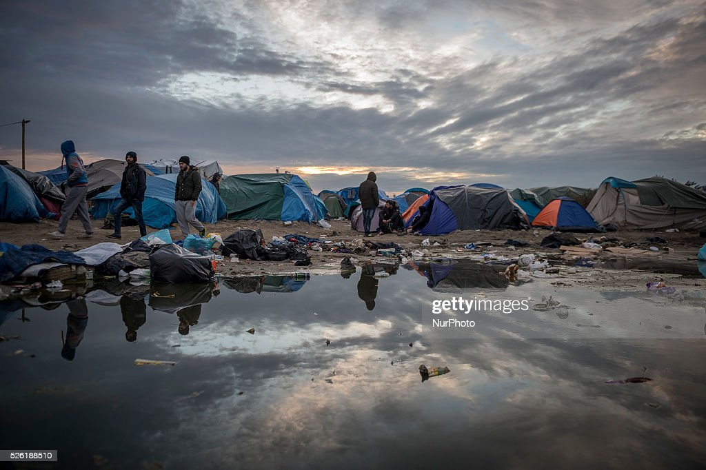"""Daily life of refugees in the """"Jungle"""" migrants camp in the northern French city of Calais on November 3, 2015. Winter is coming to Calais, raising fears among aid groups about worsening conditions for the thousand of migrants living in a makeshift camp. About 630000 migrants have entered in Europe illegal since the beginning of the year and Calais is the last hurdle before reaching England, their dream destination"""