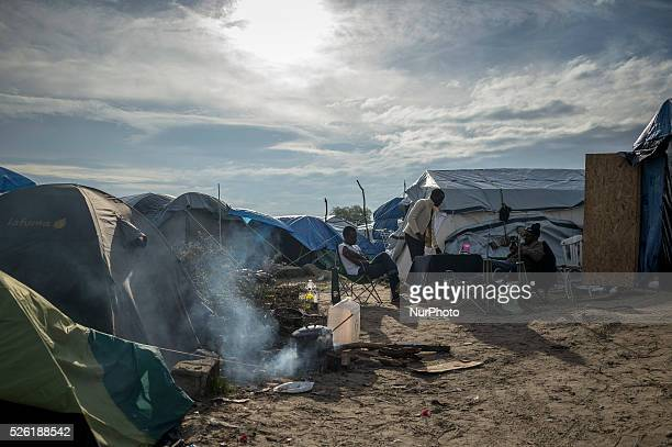 "Daily life of refugees in the ""Jungle"" migrants camp in the northern French city of Calais on November 3, 2015. Winter is coming to Calais,..."