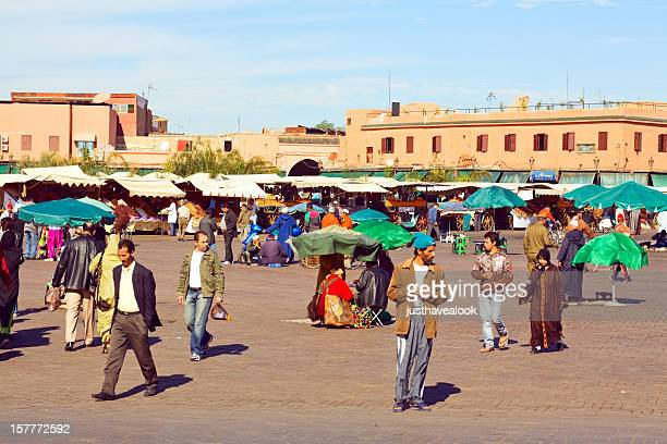 daily life on djemna el fna in marrakech - reseller stock photos and pictures