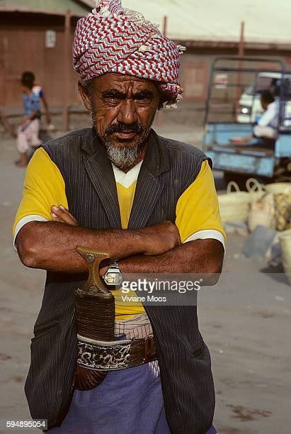 Daily life Portrait of a fisherman chewing qat and wearing his traditional dagger tucked in his belt at AlHudaydah seaport